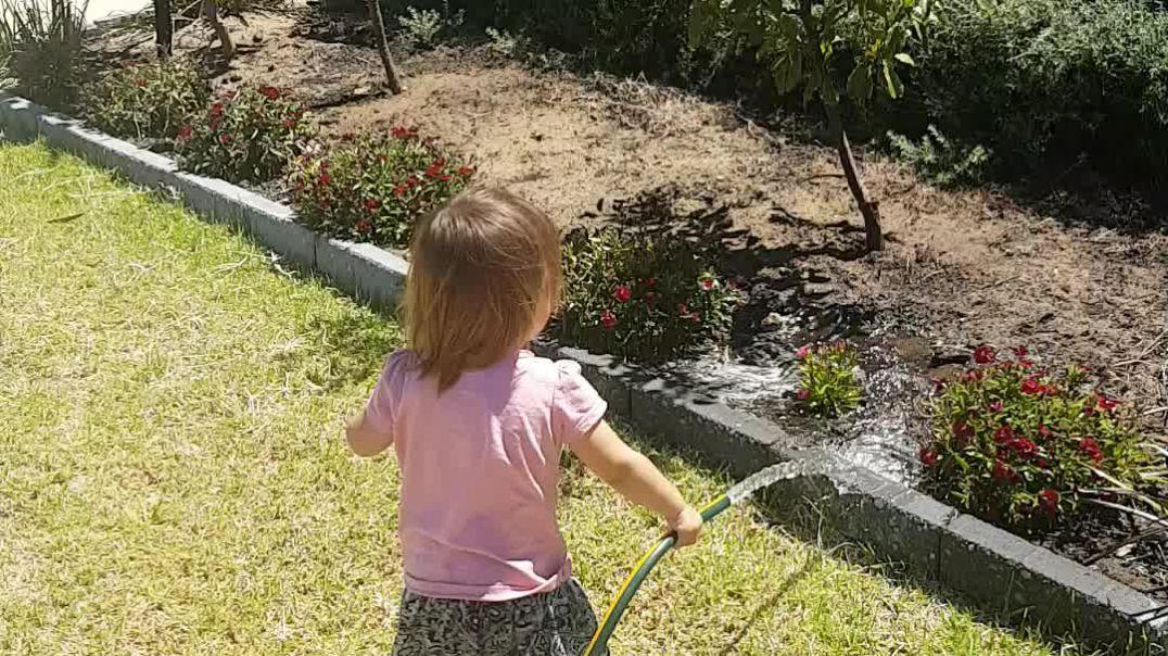 My Daughter Watering.